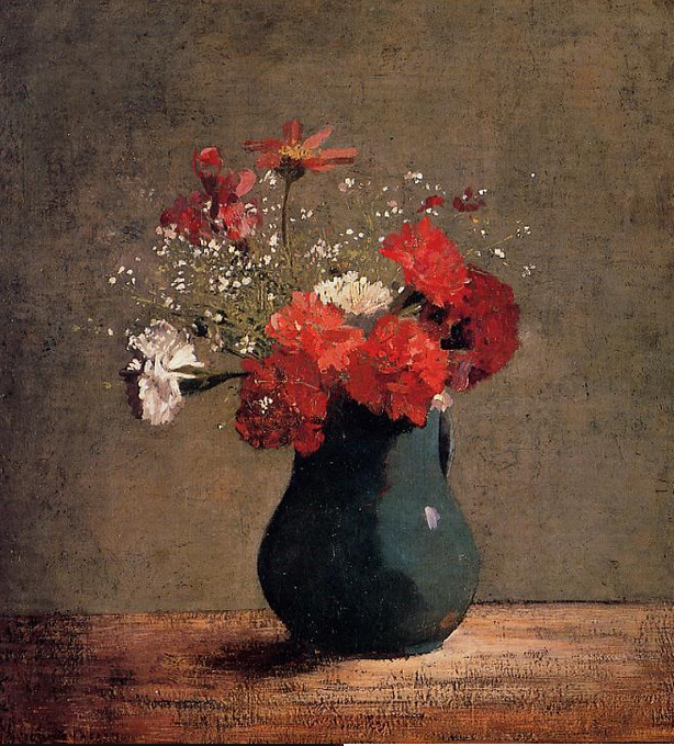 Carnations and baby's breath in a green pitcher